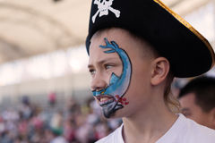Boy painting face in pirate hat Royalty Free Stock Photo