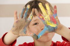 Boy is painting with finger paint Royalty Free Stock Photography