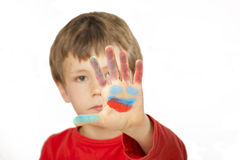 Boy is painting with finger paint Royalty Free Stock Image