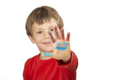 Boy is painting with finger paint Royalty Free Stock Photos