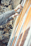 Boy painting graffiti close-up Royalty Free Stock Photo