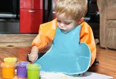 Boy painting in his room Royalty Free Stock Image