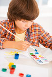 Boy painting. Royalty Free Stock Image