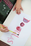Boy Painting Name On Paper In Art Class Stock Photo