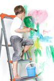 Boy painting over white Royalty Free Stock Images