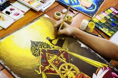 Boy painting with paintbrush and colorful paints Stock Images