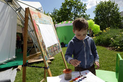 Boy painting paints Stock Photos
