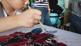 Boy painting on Thai Style art Fabric color stock footage