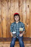 Boy painting the tool shed Stock Photography