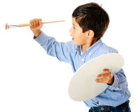 Boy painting on the wall Royalty Free Stock Photos