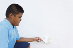 Boy painting a wall Royalty Free Stock Photography