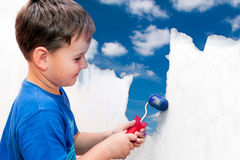 Boy painting stock photos