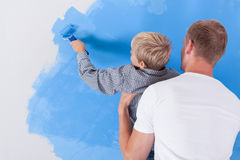 Boy painting wall Royalty Free Stock Photos