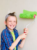 Boy painting wall Royalty Free Stock Images