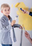 Boy painting wall Stock Photos