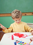 Boy Painting With Watercolors In Art Class Royalty Free Stock Image