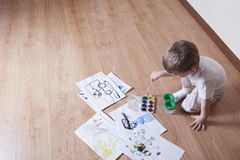 Boy Painting With Watercolors And Paintbrush Royalty Free Stock Photos