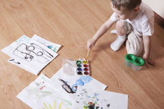 Boy Painting With Watercolors And Paintbrush Royalty Free Stock Images