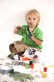 Boy with paints Royalty Free Stock Photo