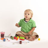 Boy with paints Royalty Free Stock Image