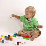 Boy with paints Stock Photos