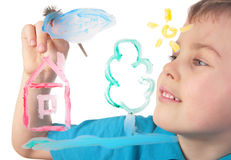 Boy paints on glass cloud and house. On white royalty free stock photo