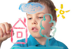 Boy paints house on glass Royalty Free Stock Images
