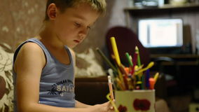 Boy paints stock video footage