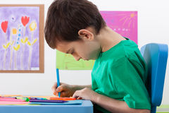 Boy paints something markers at school Stock Photo