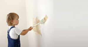 Boy paints the wall Stock Photo