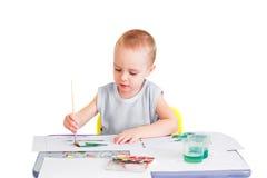 Boy paints watercolors Royalty Free Stock Photo