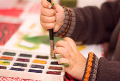 Boy paints with watercolors Royalty Free Stock Photo