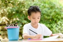 Boy paiting Stock Image