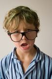 Boy in pajamas. Child wearing striped pajamas and spectacles Stock Photo