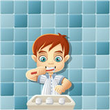 Boy in pajamas brushing teeth. Royalty Free Stock Photo