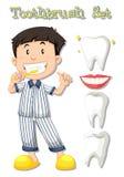 Boy in pajamas brushing teeth Royalty Free Stock Image