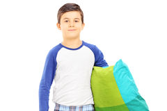 Boy in pajamas holding a pillow. Isolated on white background Royalty Free Stock Photo
