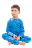 Boy in pajamas on white background Stock Image
