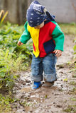 Boy palaying in mud Royalty Free Stock Image