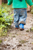 Boy palaying in mud Royalty Free Stock Photo