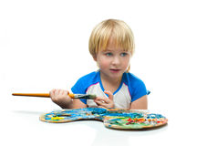 Boy with palette Stock Images