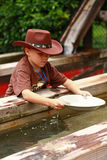 Boy panning for gold Stock Image