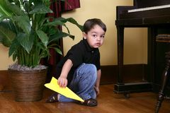 Boy with paper airplane Royalty Free Stock Images