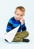 Boy and paper airplane Stock Image