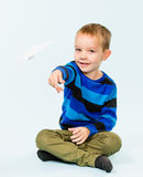 Boy and paper airplane Royalty Free Stock Photo