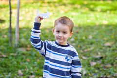 Boy with paper airplane Stock Photo