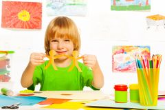Boy with paper garland. Happy 4 years old boy with paper garland Royalty Free Stock Photos