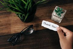 A boy with a paper note in his hands with the words THANK YOU. Appreciation concept Royalty Free Stock Image