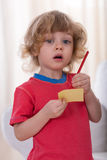 Boy with paper and pen Royalty Free Stock Images