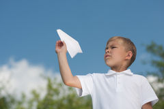 Boy with paper plane Royalty Free Stock Photography